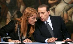 Silvio Berlusconi whispers to Tourism Minister Michela Vittoria Brambilla.