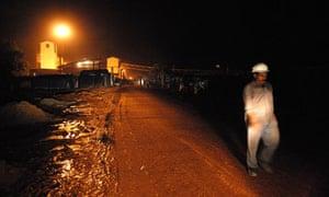 A worker leaves the Vedanta company's Lanjigarh alumina refinery