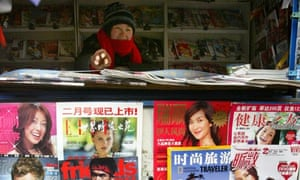 Chinese vendor sells news magazines in Beijing
