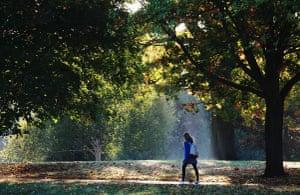 Autumn: A woman walks through Victoria Park in Bath