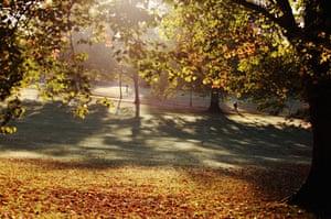 Autumn: A man walks through Victoria Park in Bath