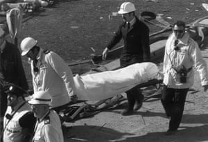 Brighton bombing 1984: Rescue workers carry a bomb victim on a stretcher