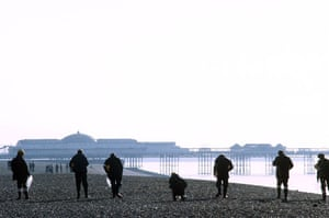 Brighton bombing 1984: Police officers search Brighton beach for evidence