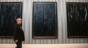 Damien Hirst No Love Lost: Artist Damien Hirst walks past part of his No Love Lost Blue Paintings