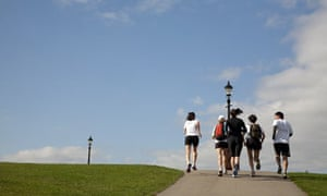 A group of runners on a jogging tour of London at Primrose Hill.