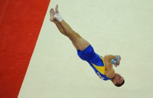 World Gymnastics : Stepan Gorbachev mid-air during a flip whilst competing on the floor