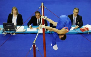 World Gymnastics : The judges watch Daniel Keatings competing on the high bar