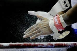 World Gymnastics : A competitor chalks their hands ready for the high bar