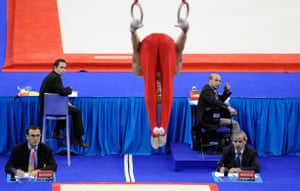 World Gymnastics : The ring judges concentrate their attention on a competitor's routine