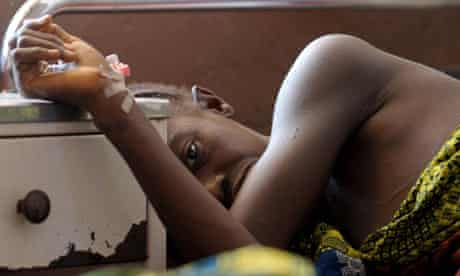 Woman waits in maternity ward in Sierra Leone