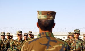 Afghan soldiers are put through training exercises by British troops at Ghar Ordoo military base.