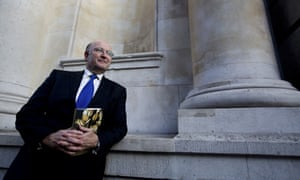 Economist Roger Bootle with his book 'The Trouble With Markets