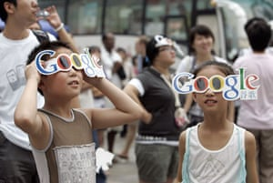 10 years: Children observe a solar eclipse with Google goggles in Wangfujing Street