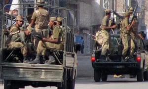 Pakistani troops maintain a curfew in Bannu on the edge of Waziristan