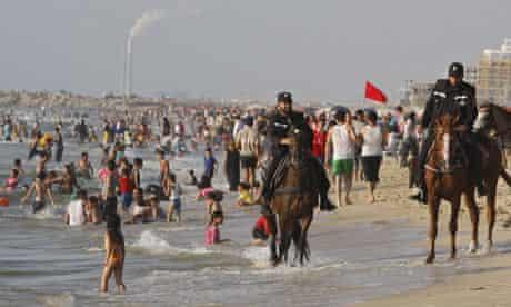 Mounted Hamas officer rides along beach at Gaza City