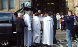 The relics of St Therese being unloaded in Newcastle.
