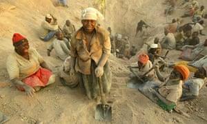 Women miners take a break from digging for diamonds in Marange, Zimbabwe