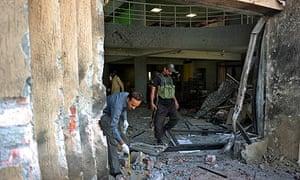 Investigators at the scene of a suicide blast in Islamabad