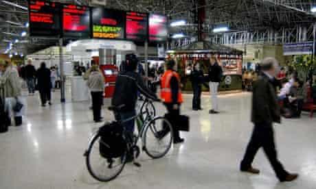 Bike blog: bikes and trains: Cyclist pushing his bicycle at Marylebone railway station in London