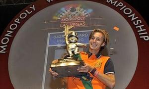 Bjørn Halvard Knappskog holds a trophy after winning the Monopoly World Championships in Las Vegas.