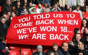 Liverpool gallery: Manchester United fans unveil a banner in the stands at Anfield
