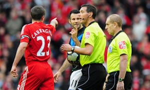 Liverpool gallery: Jamie Carragher and Ryan Giggs have words with referee Andre Marriner