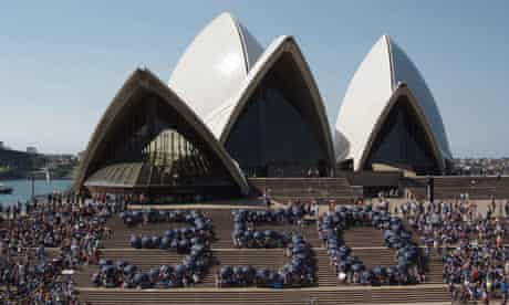 Climate change activists form the number 350 at the Sydney Opera House in Australia
