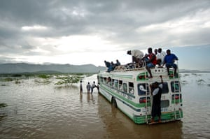 Environment decade: A bus filled with Haitian people in floods near Gonaives, Haiti