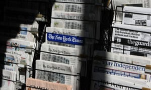 Newspapers at a news stand in San Francisco, California, 26 October 2009. Photograph: Justin Sullivan/Getty Images