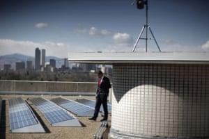 Environment decade: President Barack Obama tours the solar array at the Denver Museum