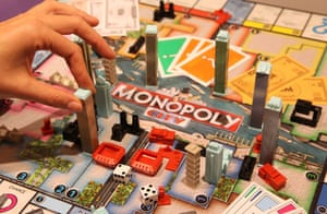 Top toys: A woman positions a tower block in the Monopoly City board game