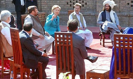 Hillary Clinton, the US secretary of state, talks to tribesmen from Pakistan's north-western areas in Islamabad.
