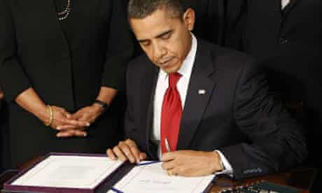 Barack Obama signs the Ryan White HIV/Aids Treatment Extension Act at the White House.