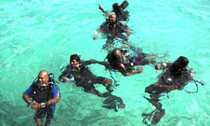Maldivian cabinet members dive in training for an underwater cabinet meeting