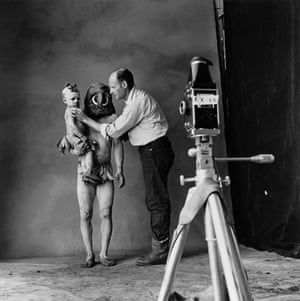 Irving Penn: Photographer Irving Penn at a shoot with a New Guinea mud man and a child