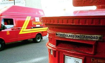 A postbox and Royal Mail van.