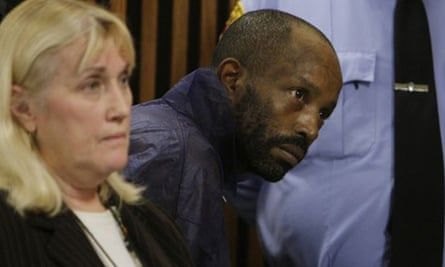 Anthony Sowell stands behind public defender Kathleen DeMetz during his court appearance in Cleveland, Ohio. Sowell faces murder charges after 10 bodies were found in his home.