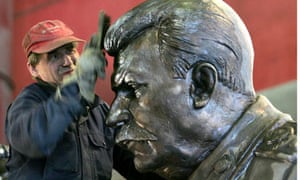 An employee cleans a sculpture of Stalin made by Tsereteli at a factory in St.Petersburg