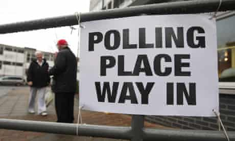 A woman arrives to cast her vote in the Glasgow North East byelection