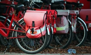 Royal Mail postman's bicycles stand in their racks at the end of the working day at Knutsford