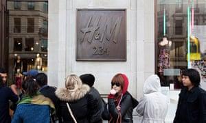 Shoppers wait outside H&M on Regent Street