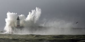 UK gales: Huge waves break over the lighthouse on Newhaven Harbour