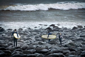 UK gales: Surfers head for the sea in wetsuits at Putsborough, North Devon