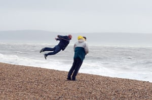 UK gales: A man on the beach gets a lift in the gusty weather
