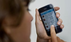 Woman checks Twitter website on iPhone