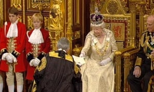 Queen Elizabeth II hands over papers after the Queen's Speech at the State Opening of Parliament.