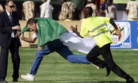 An Algerian fan on the field before the start of the World Cup qualifier between Egypt and Algeria