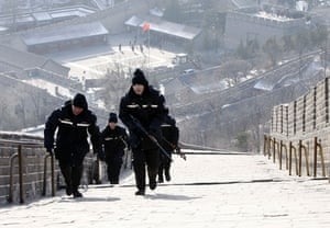Obama in Asia: Police walk up the Great Wall of China before President Obama arrives