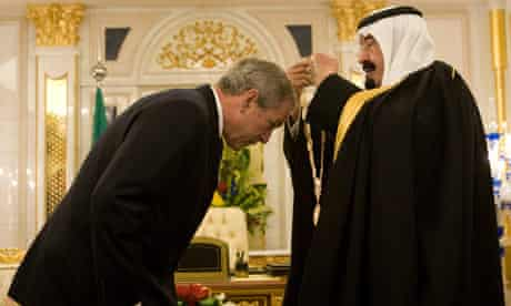 Saudi King Abdullah bin Abdul Aziz presents the King Abdul Aziz Order of Merit to George Bush