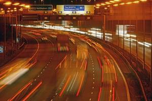M1 motorway: Traffic on the M1 motorway at junction 24 at night